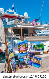 SAINT-TROPEZ, FRANCE - JUNE 06, 2013: Paintings and yacht at the promenade Quai Jean Jaures in Saint-Tropez in the Department Var of the province Provence-Alpes-Cote d Azur