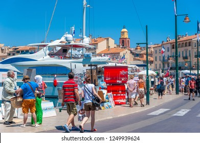 SAINT-TROPEZ, FRANCE - JUNE 06, 2013: Promenade Quai Jean Jaures with yachts and tourists in Saint-Tropez in the Department Var of the province Provence-Alpes-Cote d Azur