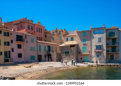 SAINT-TROPEZ, FRANCE - JUNE 06, 2013: Houses in the old fishing district at the beach de la Glaye in Saint-Tropez in the Department Var of the province Provence-Alpes-Cote d Azur