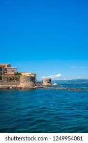 SAINT-TROPEZ, FRANCE - JUNE 06, 2013: Historic city wall with the Old Tower and the Tour du Portalet in Saint-Tropez in the Department Var of the province Provence-Alpes-Cote d Azur