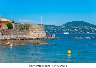SAINT-TROPEZ, FRANCE - JUNE 06, 2013: Historic city wall and the Old Tower at the old fishing harbor in Saint-Tropez in the Department Var of the province Provence-Alpes-Cote d Azur