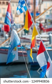 SAINT-TROPEZ, FRANCE - JUNE 10, 2013: Flags in the fishing harbor of Saint-Tropez in the Department Var of the province Provence-Alpes-Cote d Azur