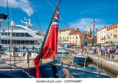 SAINT-TROPEZ, FRANCE - JUNE 10, 2013: Promenade Quai Jean Jaures with yachts and tourists in Saint-Tropez in the Department Var of the province Provence-Alpes-Cote d Azur
