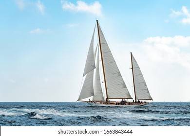 """Saint-Tropez, France, oct.1st 2019. Classic sailboat at sea with white sails in the wind.  Taken during the """"Voiles de Saint-Tropez"""" race."""
