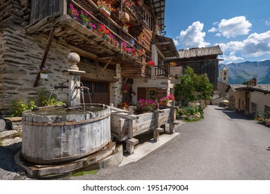 Saint-Veran, the third highest village in Europe with wooden fountain in summer. Located in the Queyras Regional Natural Park, Hautes-Alpes, French Alps, France