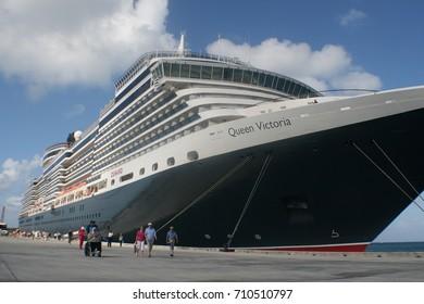 SAIPAN, CNMI— CIRCA MARCH 1, 2009: Cruise ship Queen Victoria docked at the Saipan seaport for a brief stopover. Northern Mariana Islands.