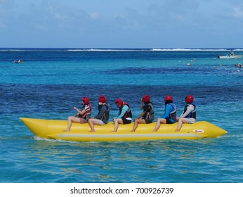 SAIPAN, CNMI—Tourists ride a banana boat at the clear blue waters of Managaha Island on Saipan, Northern Mariana Islands in December 2016.