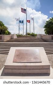 Saipan, USA - June 15 2017: Flags Waving in the Wind at American Memorial Park
