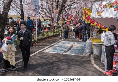 SAITAMA, JAPAN - MARCH 31ST, 2019. Crowd of people enjoying the cherry  blossom Kumagaya Sakura Tsutsumi festival.