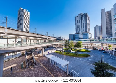 """SAITAMA, SAITAMA / JAPAN - OCTOBER 29 2018 : Scenery in front of """"Musashi-Urawa"""" station on JR line. There is a pedestrian deck and a tower apartment and a building in front of the station."""