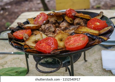 Saj kebap with mushrooms chicken. Outdoor picnic table.