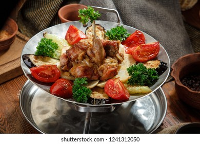 saj with meat and vegetables