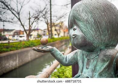 SAKAIMINATO, JAPAN - Novermber 26, 2015: Bronze statues of 'GeGeGe no Kitaro' Main character on Mizuki Shigeru road, Sakaiminato, Tottori.