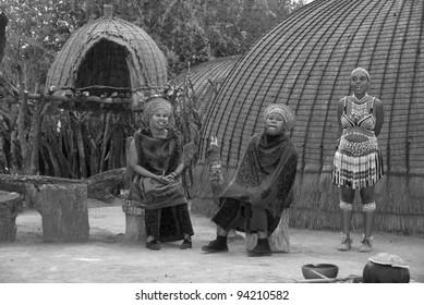 SAKALAND-NOVEMBER 27 : unidentified young women wear traditional Zulu clothing, made local beer with wheat on November 27, 2010 Shakaland Zulu Cultural Village, KwaZulu-Natal, South Africa