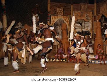 SAKALAND-NOVEMBER 27 : Unidentified Zulu dancers wear traditional Zulu clothing, during presentation of a Zulu show on November 27, 2010 Shakaland Zulu Cultural Village, KwaZulu-Natal, South Africa