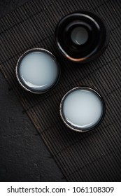 Sake in ceramic bowls, top view.