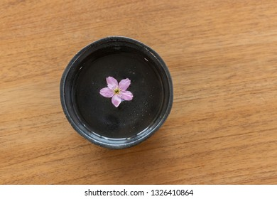 Sake with cherry petals floating