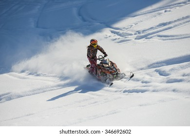"SAKHALIN RUSSIAN - JANUARY 23 : Oleg Bibikov moving snowmobile in winter forest in the mountains of Sakhalin Island in ""Sakhalin sprint 2015""  on  January 23, 2015 in Sakhalin Russia"