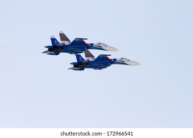 SAKHIR AIRBASE, BAHRAIN - JANUARY 16: Flying display and aerobatic show of Russian Knights in Bahrain International Airshow at Sakhir Airbase, Bahrain on 16 January, 2014