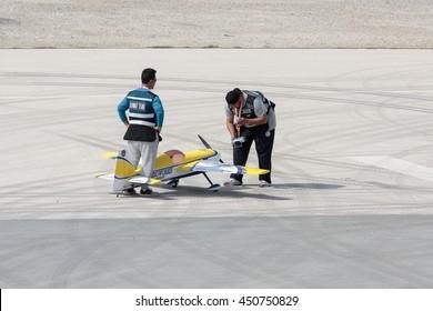 SAKHIR AIRBASE, BAHRAIN - JANUARY 22, 2016: Kuwait Display Team checking the model aircraft before its aerobatic display in Bahrain International Airshow.