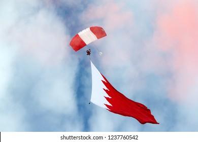 SAKHIR, BAHRAIN - NOVEMBER 14: BDF  Parachute Display Team performs in Bahrain International Airshow at Sakhir Airbase, Bahrain on 14 November, 2018