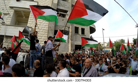 SAKHNIN, ISRAEL- OCTOBER 13: MK Member of Knesset Basel Ghattas attends anti Israel protest with PLO flags, demand liberation of Al Aqsa mosque and occupied territories, solidarity with Palestinians