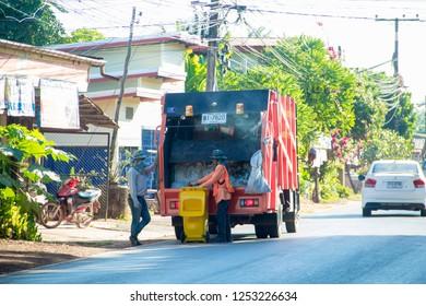 Sakon Nakhon ,Thailand,December 05,2018:Waste trucks,Garbage collector on the garbage truck,Garbage collector is collecting garbage on the garbage truck.Sakon Nakhonm,Thailand.