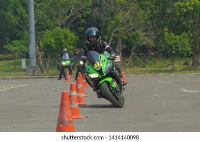 Kawasaki Motorcycle Images, Stock Photos & Vectors