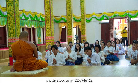 Sakon Nakhon,Thailand, July 27-2018: Buddhists make merit in meditation on the Asanha Puja Day and the Buddhist Lent Day,Ordained as a Hindu priest,on Thailand,
