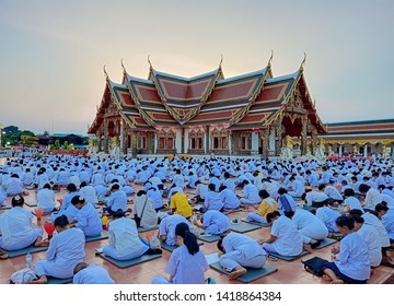 Sakon Nakhon,Thailand,May 18,2019:Vesak Day,Buddhists are all dressed in white. To pay homage to the monks, praying and preserving the sacrament on Visakha Puja Day,Wat Phra That Choeng Chum,Thailand.