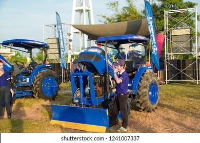 Sakon Nakhon,Thailand,November 24,2018:ISEKI Tractor,Employees are presenting the use of a large-scale tractor farm tractor, Diese, by IST Farm Machinery Co., Ltd., who brought him from Japan.Thailand