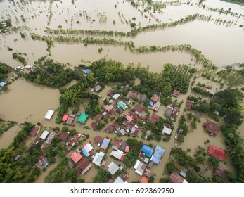 Sakonnakhon, Thailand - August 3, 2017 (Ban kang tha lap village,Kusumal district,Sakonnakhon) : Flood waters overtake a house and rice field in northeast of Thailand from above view by drone