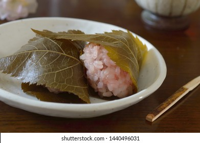 Sakura mochi is a dessert made with Japanese glutinous rice stuffed with  red bean paste. The sweet is commonly served in spring.