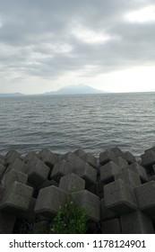 sakurajima mountain ocean wave
