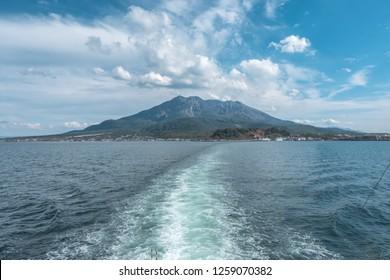 Sakurajima mountain, sea and blue sky background, Kagoshima, Kyushu, Japan
