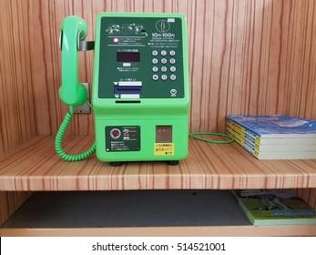 Sakurajima,Japan-September 18th,2016. Public phone booth and phone books at Sakurajima Port.