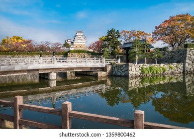 Sakuramon-bashi bridge over the inner moat at the entry gate of Himeji Castle also called 'White Egret Castle' in autumn located in Himeji City, Hyogo Prefecture of Japan.