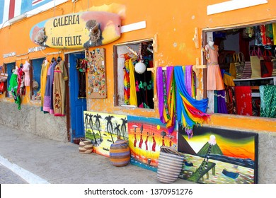 SAL, CAPE VERDE, AFRICA - December 21, 2017. Store front of art gallery with display of paintings, clothing, baskets and souvenirs in old town street.