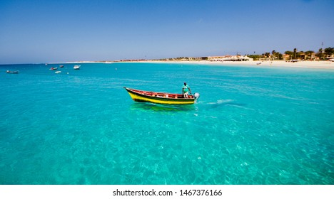 SAL ISLAND, CAPE VERDE - APRIL 2019: local fisherman on his colorful boat fishing in the transparent and clear turquoise water of the Sal island, Cape Verde arcipelago