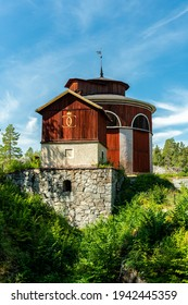 Sala, Sweden, 17-08-2020. Beautiful summer view of an old wooden mining building at the silver mine in Sala, Sweden. With the mark of  King Carl XI, 1655-1697