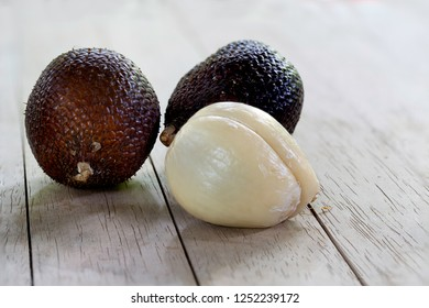Salacca fruit sweet thai fruit on wooden table
