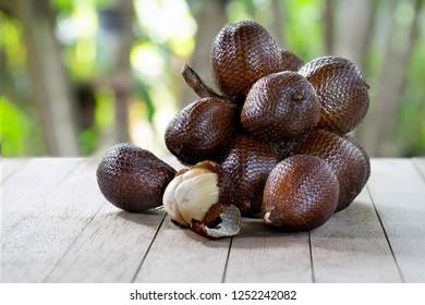 Salacca fruit sweet thai fruit on wooden table  - Shutterstock ID 1252242082
