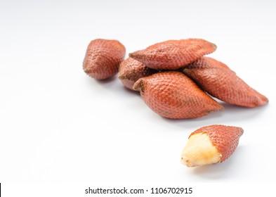 Salacca or salak fruit peeled and not peeled isolated on white background.
