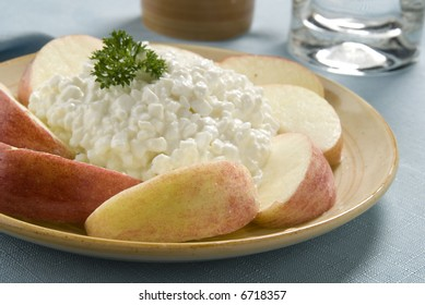 A salad of apples, cottage cheese and parsley