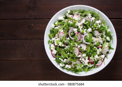 Salad with arugula, cottage cheese, radish and red onion