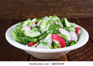 Salad with arugula, cucumber, cottage cheese and radish