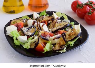 Salad with aubergine, tomato, mozzarella, iceberg lettuce