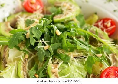Salad with avocado and arugula macro. Healthy salad recipe
