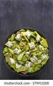 Salad with avocado, cucumber,cheese and red onion