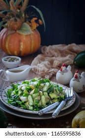 Salad with avocado pear cucumber and pumpkin seeds